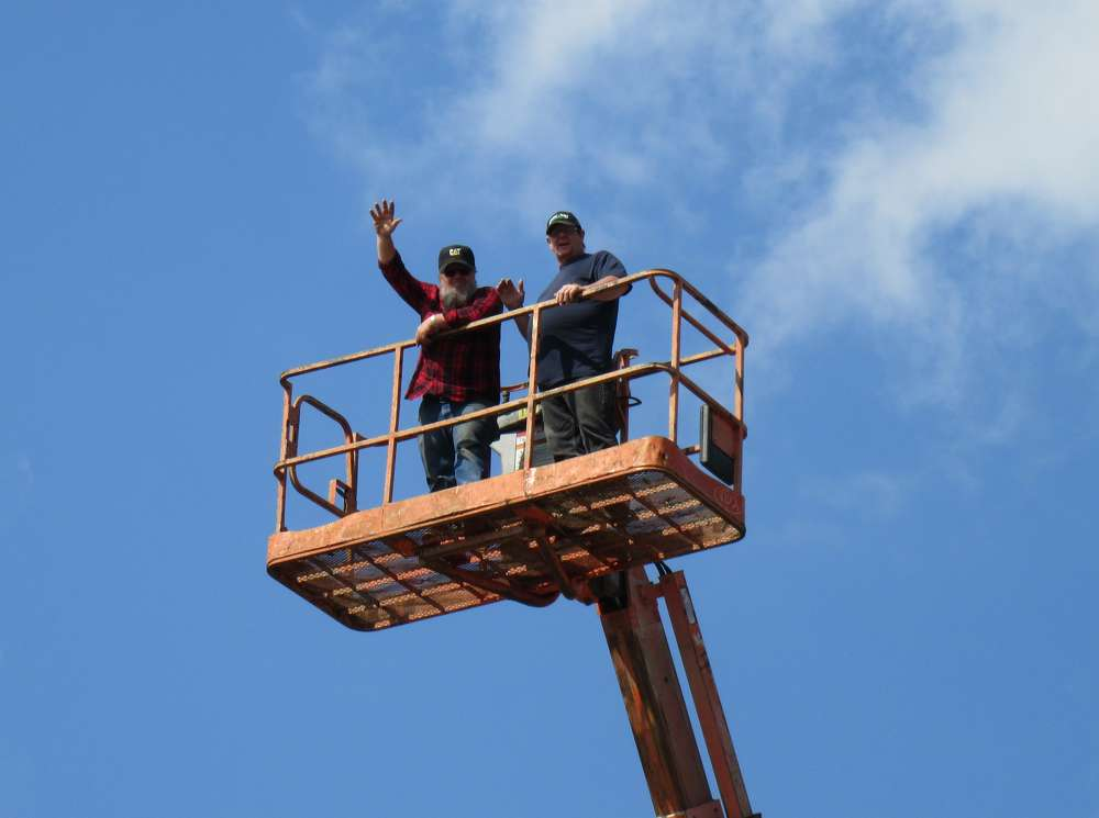 Roy Livengood (L) and Greg Spangler of Metro Erecting found a convenient perch to watch to auction