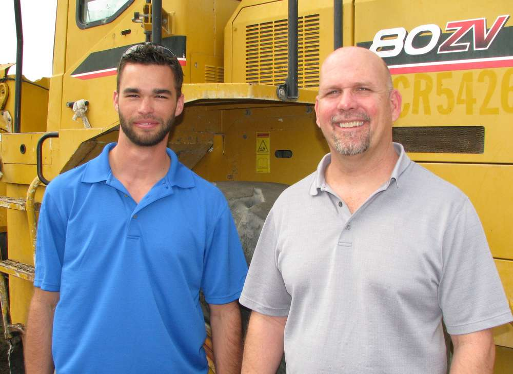 Jared Wilson (L) and Ray Ferwerda Jr. of GS Equipment, Florida's Kawasaki dealer, were out looking over the wheel loader lineup.