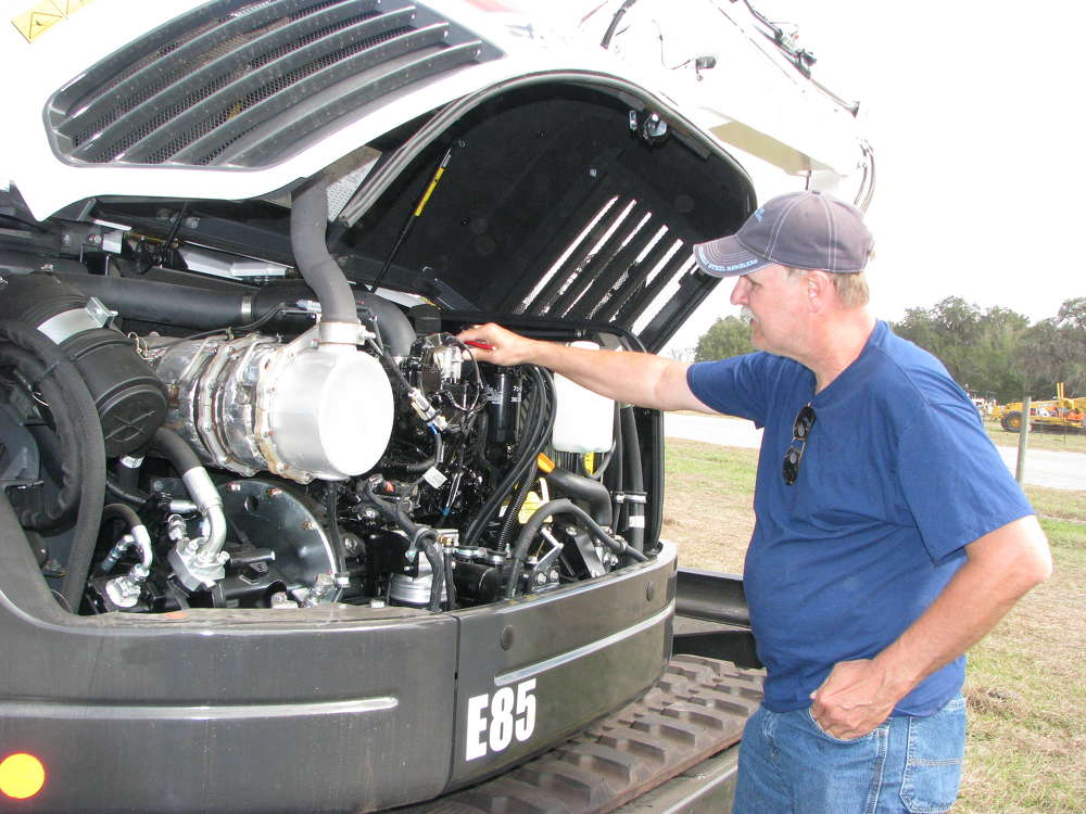 Inspecting a Bobcat E85 mini-excavator is Kerry Abramson of KGM Contractors, Angora, Minn.