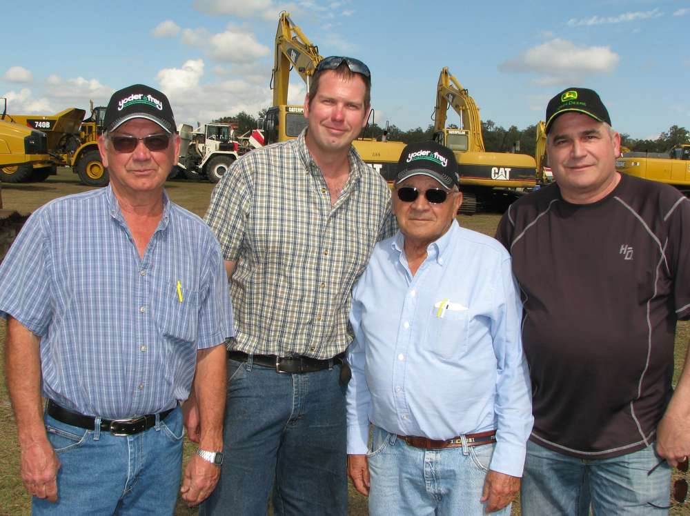 Previewing the excavators the day before they went on the block (L-R) are Rick Barnes and Tom Barnes of Barnes Excavating, Plattsburgh, N.Y.; Roswell Beeman of Roswell Beeman Trucking, Chazy, N.Y.; and Kevin Beeman of Kevin Beeman Trucking, Chazy, N.Y.