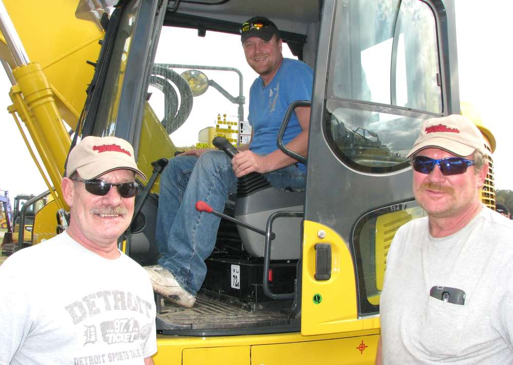 (L-R): Joe Gerardi, Doug Wendorf and Todd Wendorf of Astec Asphalt, Brown City, Mich., had plans to bid on some of the mid-sized excavators in the sale lineup.