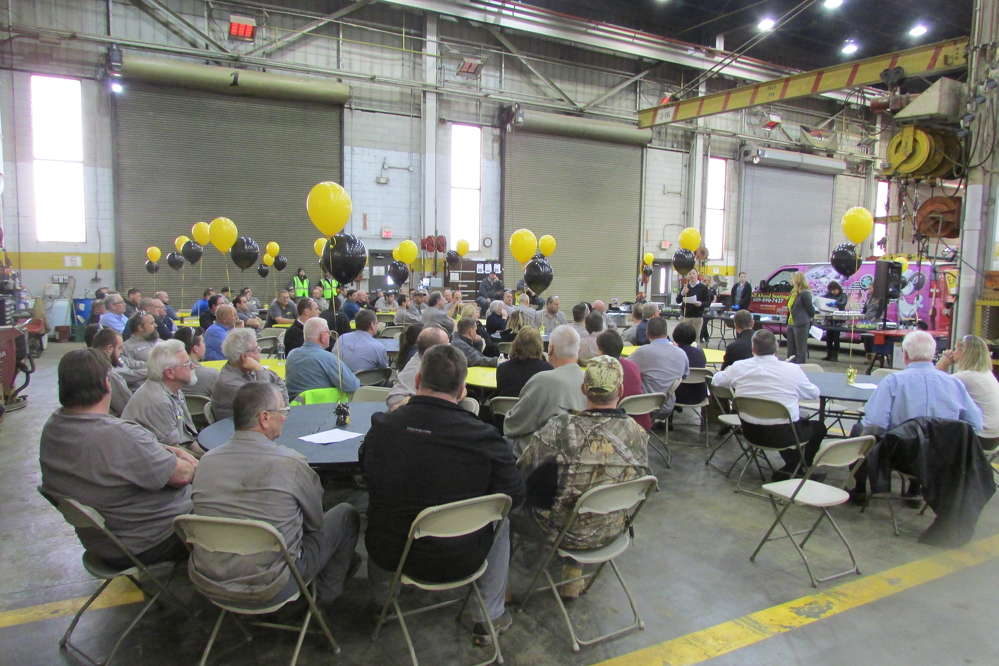 Ransome CAT employees listen as Sebastian Haas, general service manager, announces the winners of the 2017 Frank Scott Memorial Service award.