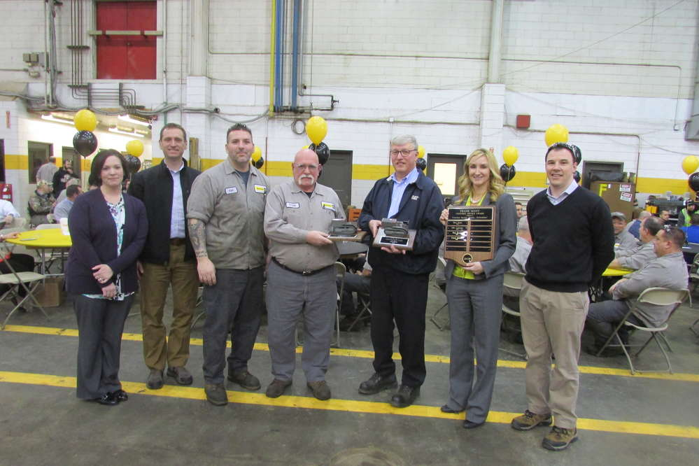 During the award ceremony (L-R) are Frank Scott's children, Denise Feger; Frank Scott Jr.; and Ransome CAT employee Ken Scott, 1st Class mechanic; co-winner Frank Mattis, technical shop specialist; co-winner Paul Pacek, service manager; Kristin Bromley-Fitzgerald, Ransome CAT president; and Sebastian Haas, general service manager.