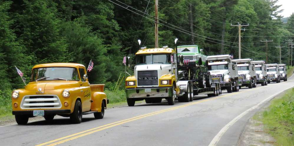 The Hiltz trucks parade down the highway.