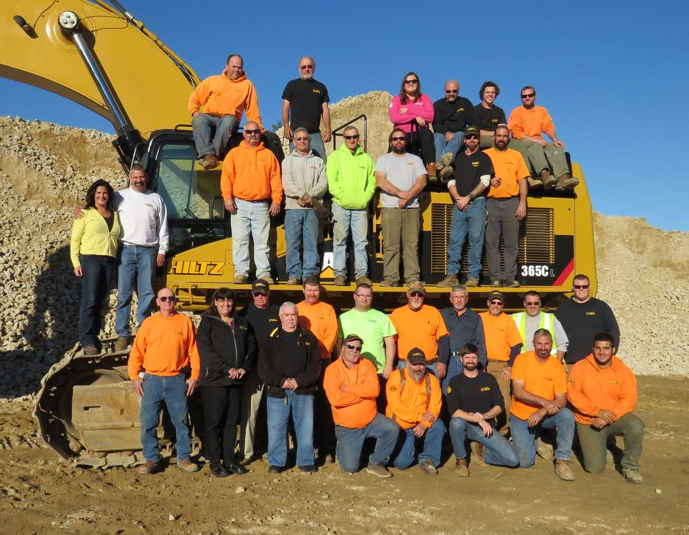 The Hiltz Excavating team — and a Cat 365CL hydraulic excavator.
