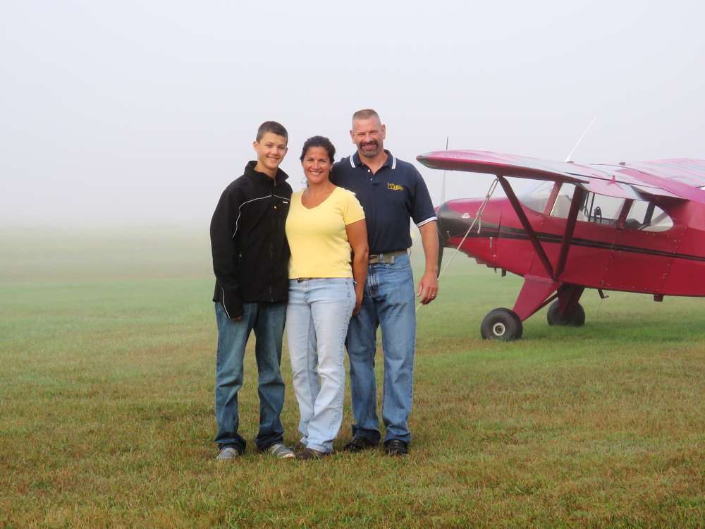 The Hiltz family waits for fog to lift to fly during a commercial shoot for his bank.