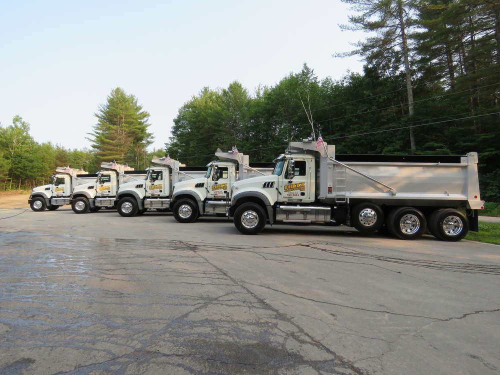 The trucks are lined up and ready for a parade.
