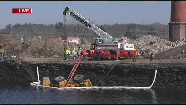 The payloader went into the Lower Leval Canal along Water Street in the Flats of Holyoke on Feb. 22 in the  afternoon. Via WWLP