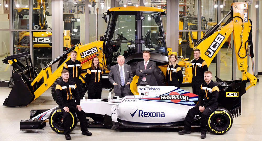 JCB Chairman Lord Bamford (center left) and JCB CEO Graeme Macdonald pose with JCB apprentices (l-r) Kyle Hare, Charlie Trotter, Jade Holmes, Chelsea Saunders, James Mohan and Daniel Malbon at the announcement of the new partnership agreement between JCB and Williams Martini Racing.