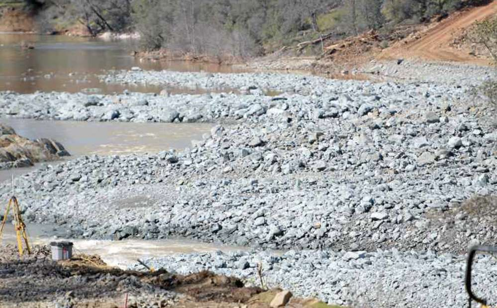 An estimated  55,556 truck loads of debris will be hauled away and dumped near the dam.