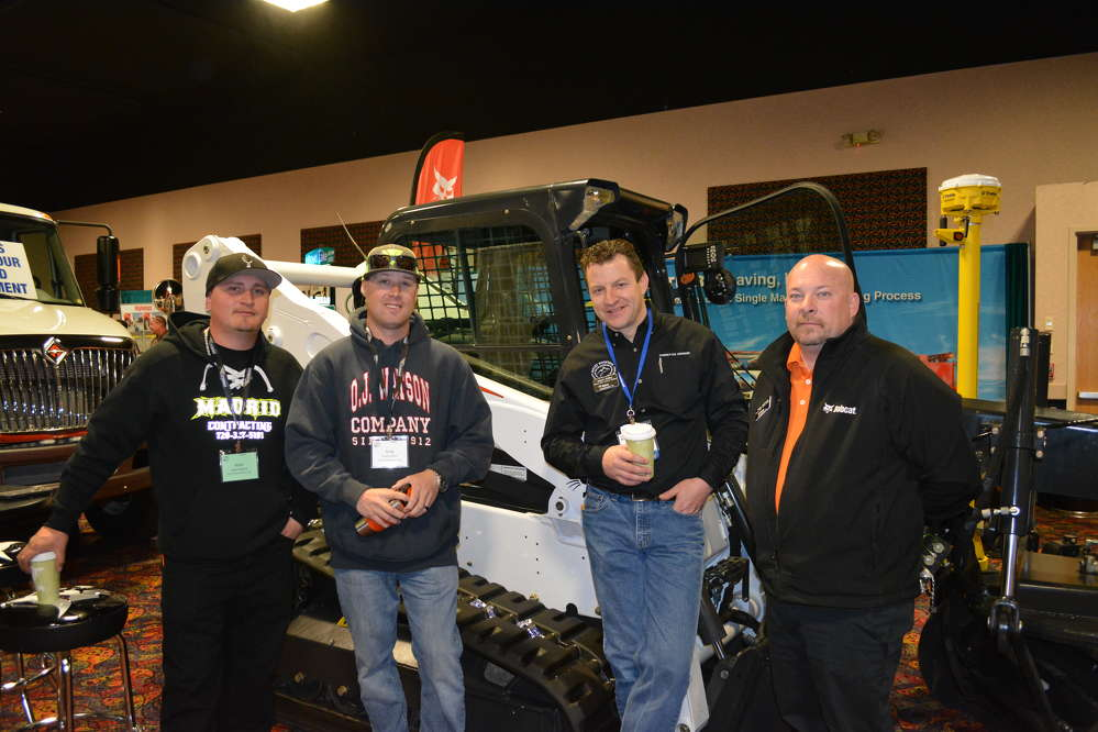 (L-R): Commerce City DPW employees Nathan Madrid and Greg Fischer speak with Rocky Mountain Bobcat's Jason Kelley and Rollie McDaniel.