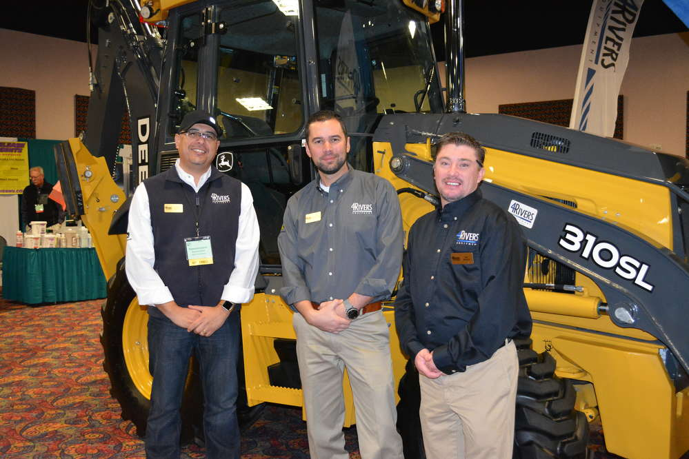 Among the Deere construction machines on display in the 4 Rivers Equipment booth was the 310 SL backhoe loader. Pictured with the backhoe (L-R) are Carlos Coons, David Middleton and Jeff Bandy, 4 Rivers territory managers.
