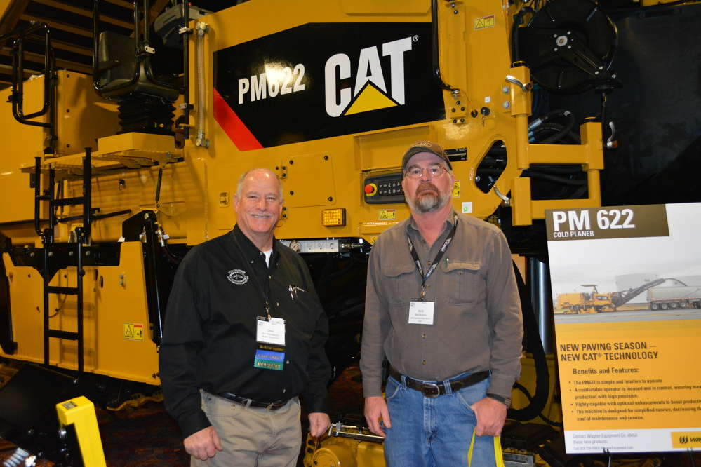 Wagner CAT Paving product specialist Don Woolworth (L) was a busy man for all three days of the show.  Here he answers questions about the Cat PM22 milling machine from Neal Bowers of Weld County DPW.