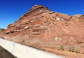 ADOT photo Crews will use heavy equipment to break up and haul away an estimated 45,000 tons (40,823 t) of rocks, dirt and clay from this rocky slope on westbound Interstate 40, about 6 mi. (9.65 km) west of Holbrook.