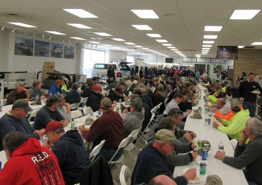 The open house attracted approximately 140 customers, seen here enjoying a catered lunch.