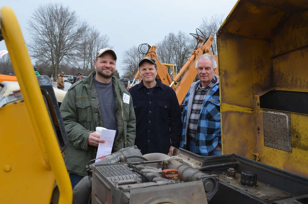 (L-R): James Montiglio, Thomas Montiglio and James Montiglio Sr. are all owners of James Montiglio Inc. in Long Island, N.Y., and are looking to add their equipment fleet during the Hunyady Auction Company sale in Perkasie, Pa.