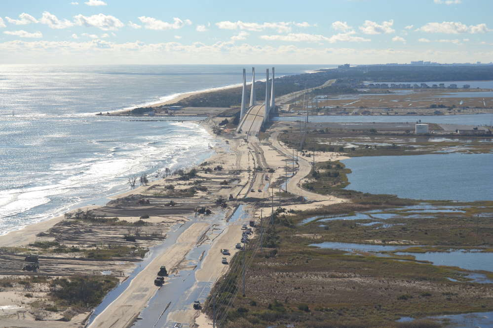 Delaware Department of Natural Resources photo Hurricane Sandy caused overwash and flooding at the north shore of the Indian River Inlet. Route 1 was closed for several days. The U.S. Army Corps of Engineers Philadelphia District helped restore the north shore by pumping more than half a million cu. yds. (382,000 cu m) of sand from the inlet onto the beach and constructing a dune.