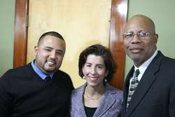Jhonny Leyva (L), president of Heroica Construction, and Stanford Cameron (R) senior project manager of Heroica Construction, join Gov. Gina Raimondo to promote MBE's in Rhode Island.
