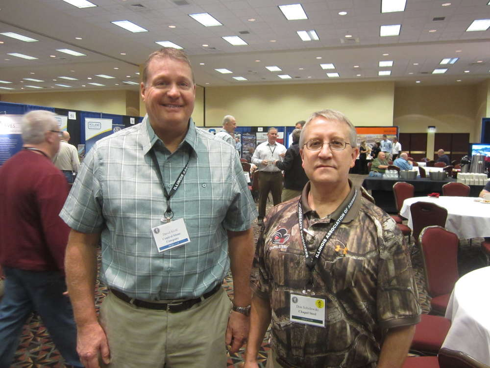 David Sivill (L) of Central Stone Co. and Don Sobolewski of Chapel Steel tour the associates expo area.