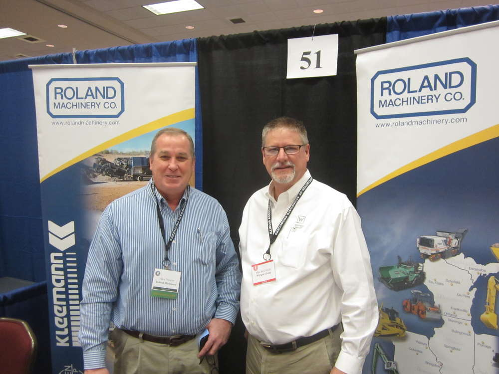 Mike Brunson (L), Roland Machinery, and Mike McCullock, Wirtgen Group, chat at the Roland Machinery booth.