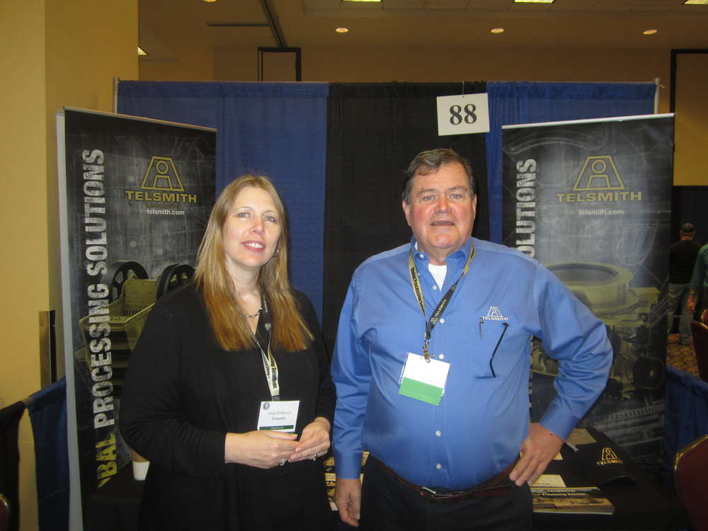 Ann Redmond (L) and Jerry Sammons, both of Telsmith, attend the show.