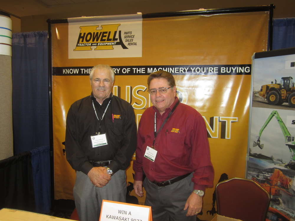 Alan Johnson (L) and Phil Linoski, both of Howell Tractor and Equipment, showcase the company's mining product line.