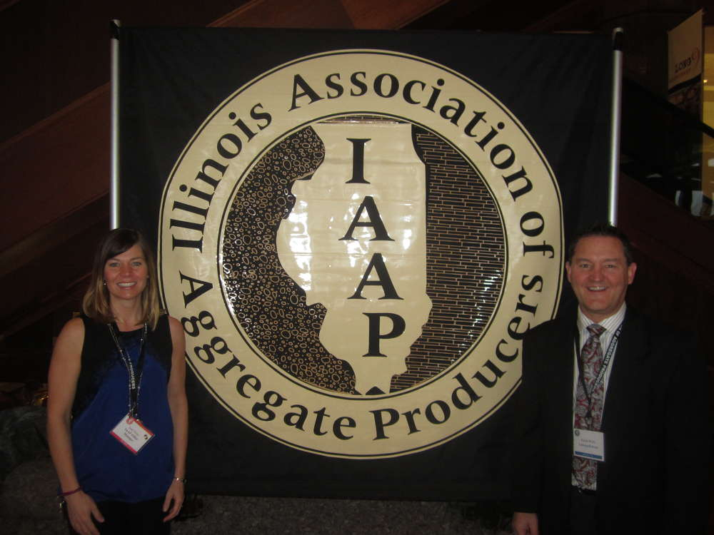 Jodi Perez (L), IAAP office manager, and Randi Wille of LaFargeHolcim welcome the attendees to the annual convention.
