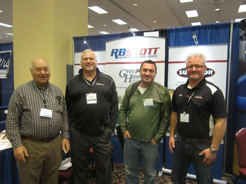 (L-R): Donald Hastie of Hastie Mining; Craig Wood, RB Scott; Cary Lampert, United Contractors Midwest; and Kevin Beyer, Superior Industries, explore the convention booths