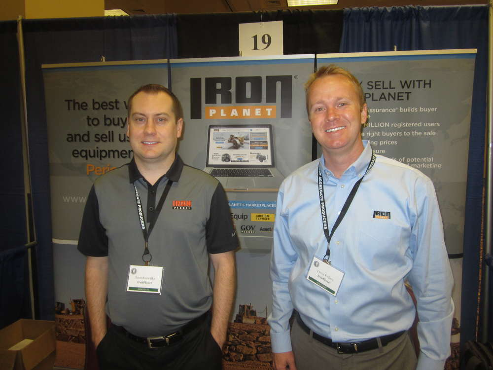 Scott Rozwalka (L) and David Kidney represent IronPlanet at the IAAP convention.
