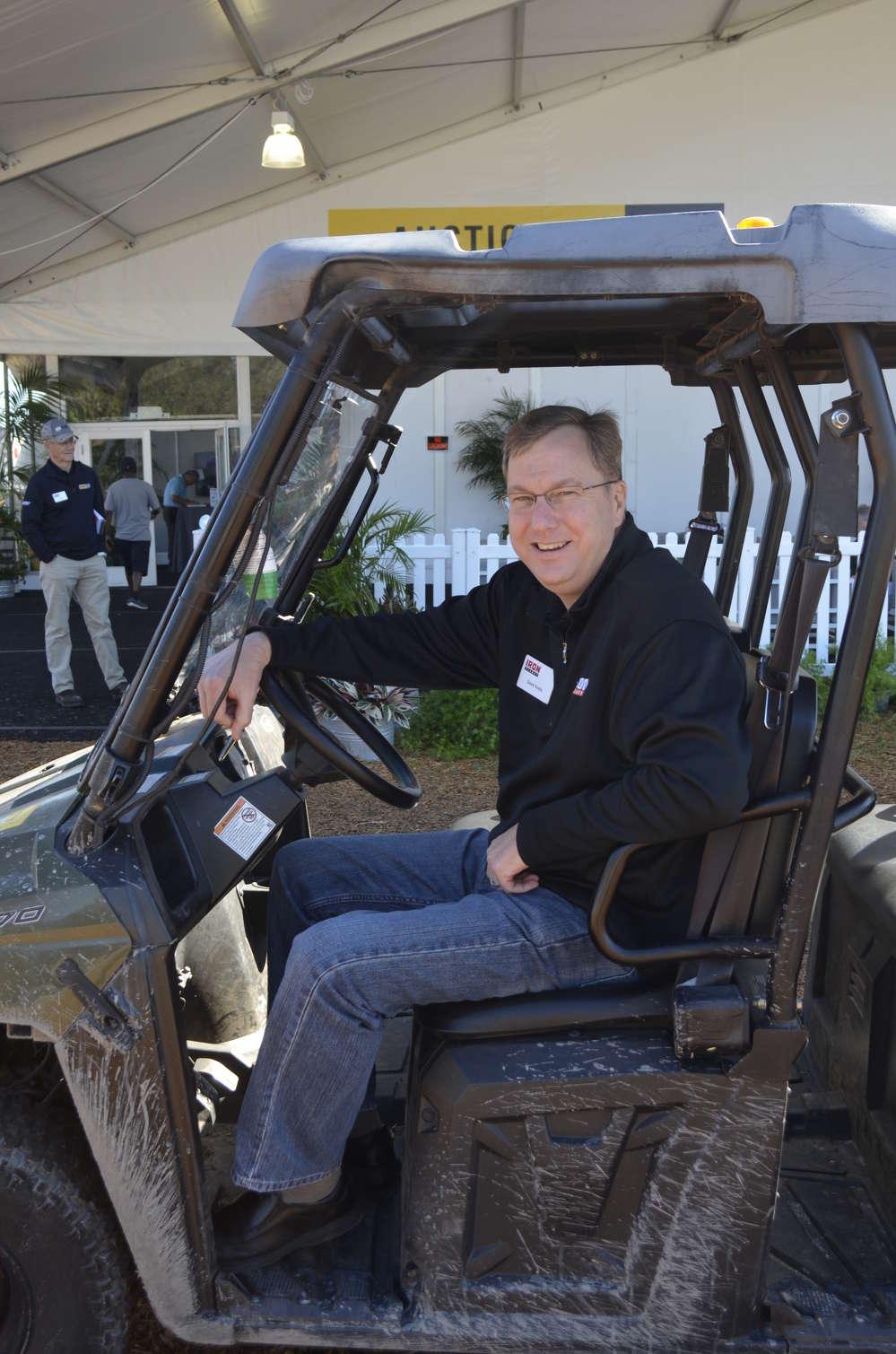 Dave Kreis of IronPlanet shuttles prospective buyers across the sale site.