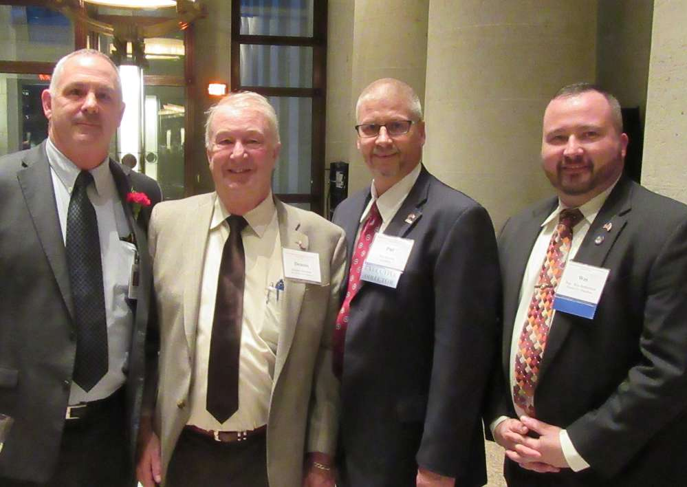 (L-R): Steve Huffman, Ohio state representative, District 80; Dennis Garrison of Melvin Stone Company; Pat Jacomet, OAIMA executive director; and Wes Retherford, Ohio state representative, District 51, caught up at the reception.