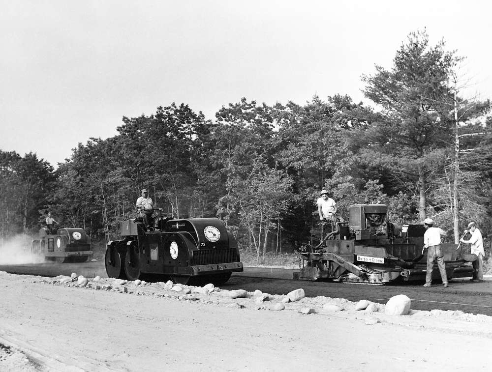 Edgar Browning photo. Shown here is a Barber Greene 879A asphalt finisher operated by B. Perini & Sons (Perini Corp.) on the original Maine Turnpike in 1947.