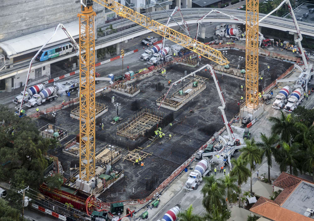CMC Group? photo. In January, after months of piling and excavation subterranean work, roughly 700  workers poured the foundation for CMC Group's 64-story Brickell Flatiron condominium.