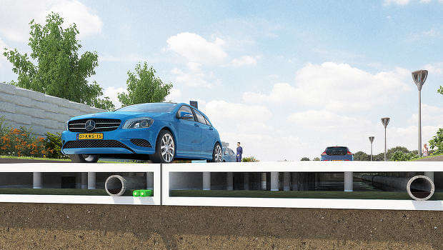 The plastic roads are modular and can house pipes in between the pieces and the ground.