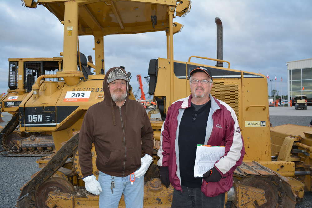 Billy Creek (L) and Gary Blackmor of Blackmor Land and Cattle, College Station, Texas, put the Cat D5N through its paces before bidding.