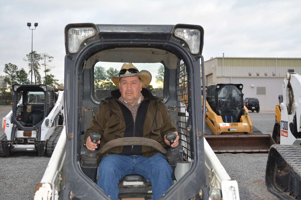 Fausto Casas of Five Star Ready Mix was bidding on one of several Bobcat skid steers that were up for sale.
