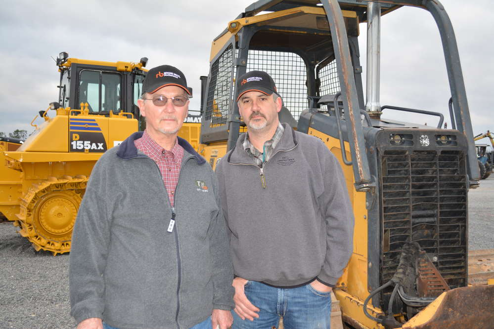 John McClendon (L) and Sidney McClain of Houlka, Miss., were interested in dozers, particularly the Deere 450J. McClendon owns McClendon Farm Equipment in Houlka.