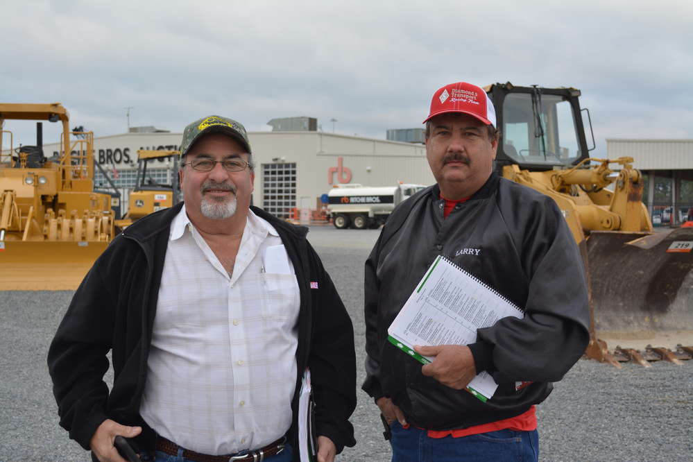 Paul Gonzalez (L) of W.P. Machinery and Larry Skloss of Diamond S Construction traveled from San Antonio to bid on equipment.