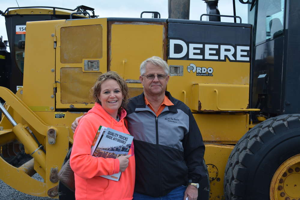 Brandi Wilson (L) and Randy Davis of Wilson Contracting flew in for the day from Wichita Falls, Texas. They were checking out several pieces, including a Deere 772D motorgrader. Wilson primarily does demolition work.