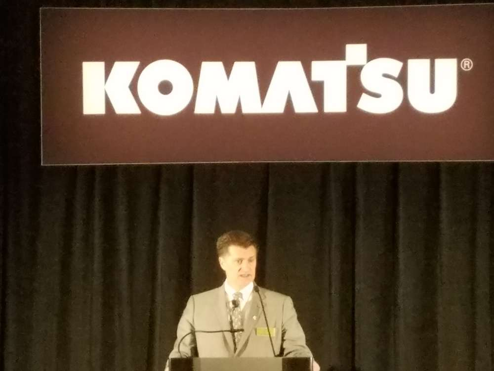 Rod Schrader, Komatsu president and CEO, addresses the media during the company's press conference at ConExpo.