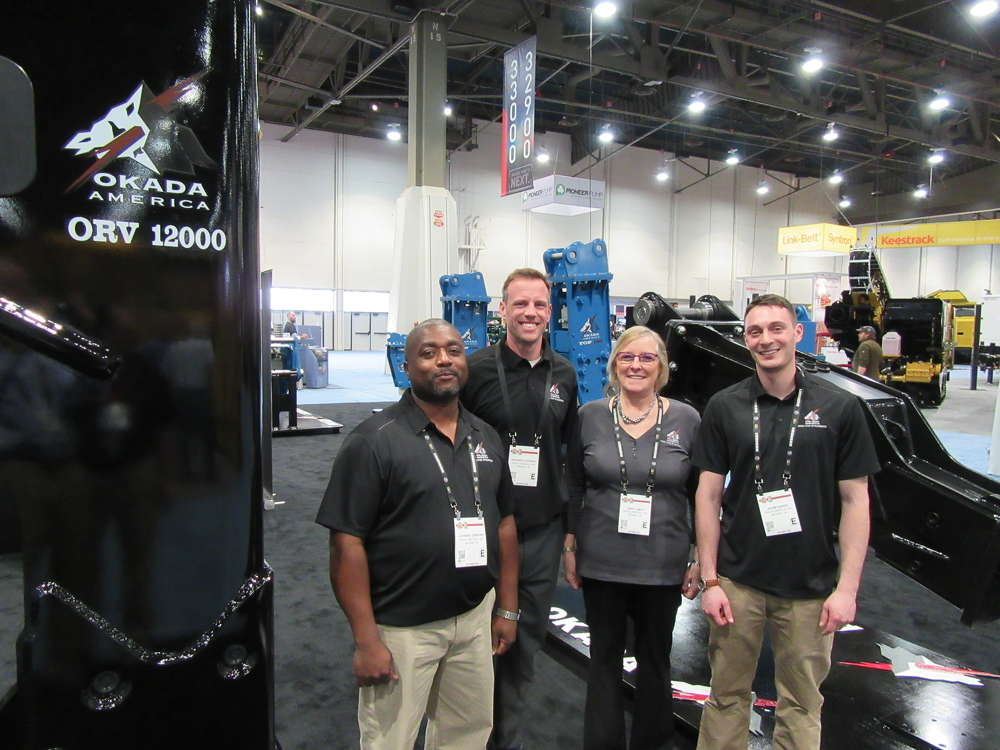 (L-R): Okada America's Johnnie Gibbons, Geordie Stewart, Cindy Smith and Adam Daher were on hand to discuss the company's selection of hydraulic breakers, compactors, crushers, shears and trommel buckets.