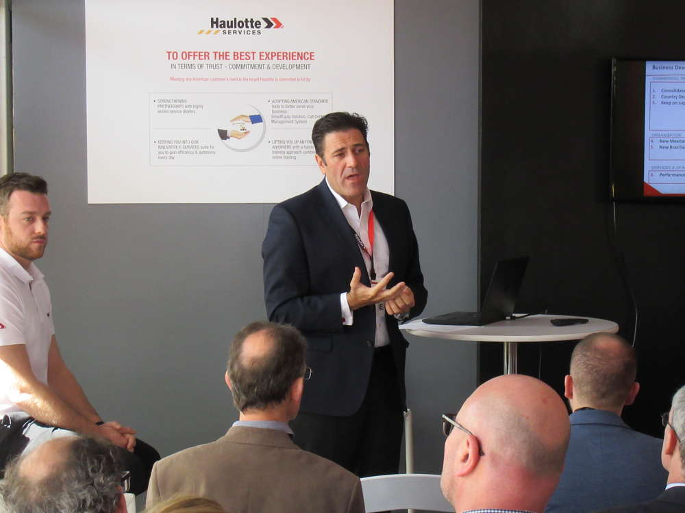 Carlos Hernandez, executive managing director of the Americas, Haulotte Group, discusses market trends and equipment innovations during a press conference at ConExpo