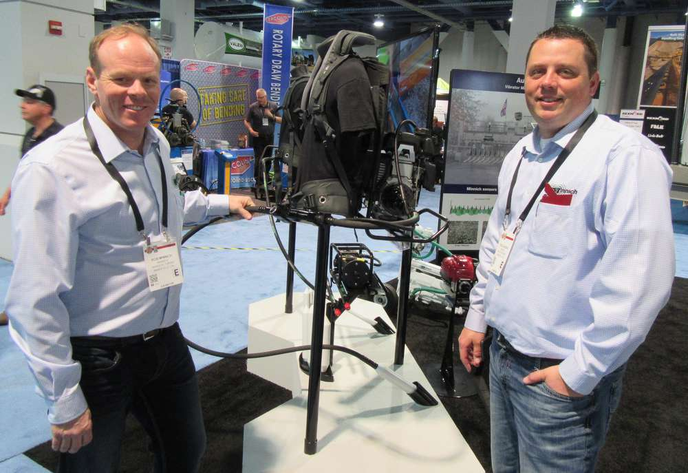 Minnich Manufacturing's Rob Minnich (L) and Todd Jurjevic presented a prototype 50CC Backpack Vibrator with quick disconnect hose and a new harness set for release in late summer this year.