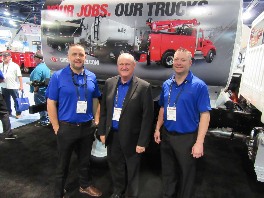 Company's Chris Wilson, Ralph Dodge and Andy Perrin were on hand to discuss the company's lineup of commercial service vehicles.