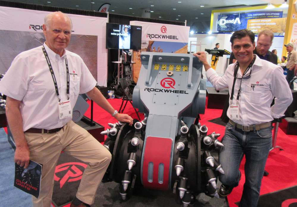 Frank Pitkin (L) and Chip Kogelmann of Alpine discussed the company's line of RockWheel rock and concrete grinders at the show