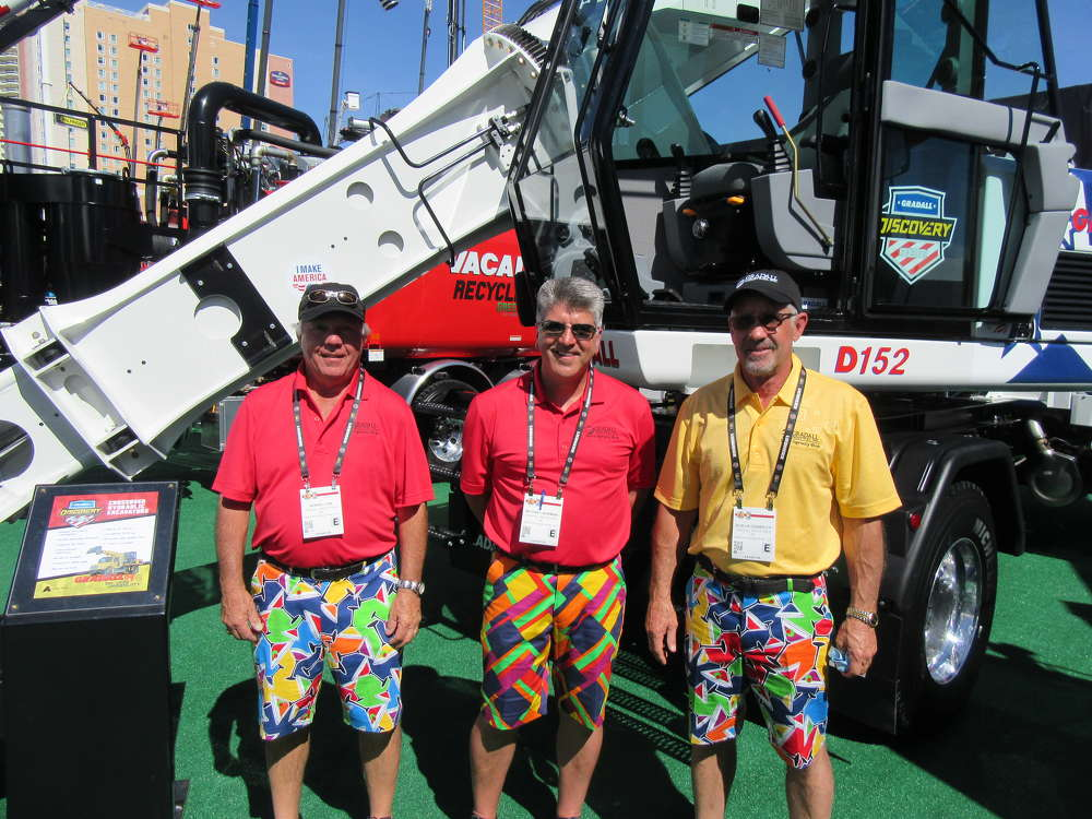 (L-R): Given their choice of attire and impressive lineup of machines it was hard to miss Bernie Linn, Michael Norman and Bob Heidenreich, all of Gradall, at the show.