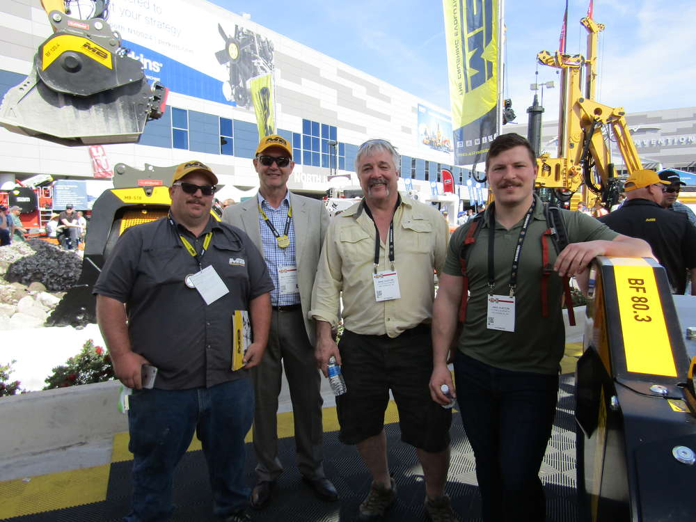 MB America had live crushing demos of its MB Crusher line throughout the show. (L-R): Chris Ballengee, area manager of MB; CEO Max Ravazzolo, along with customers Mike and John Huston of Totem Equipment of Anchorage, Ak.