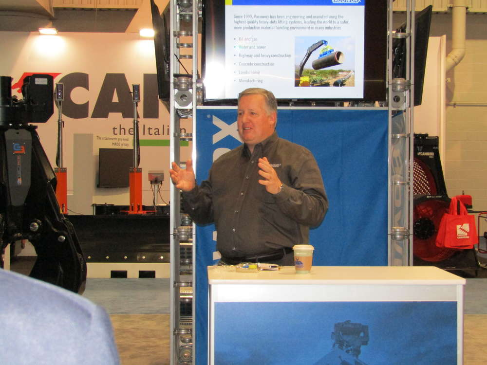 Vacuworx President Bill Solomon discusses his company's lifting solution products with members of the media at ConExpo.