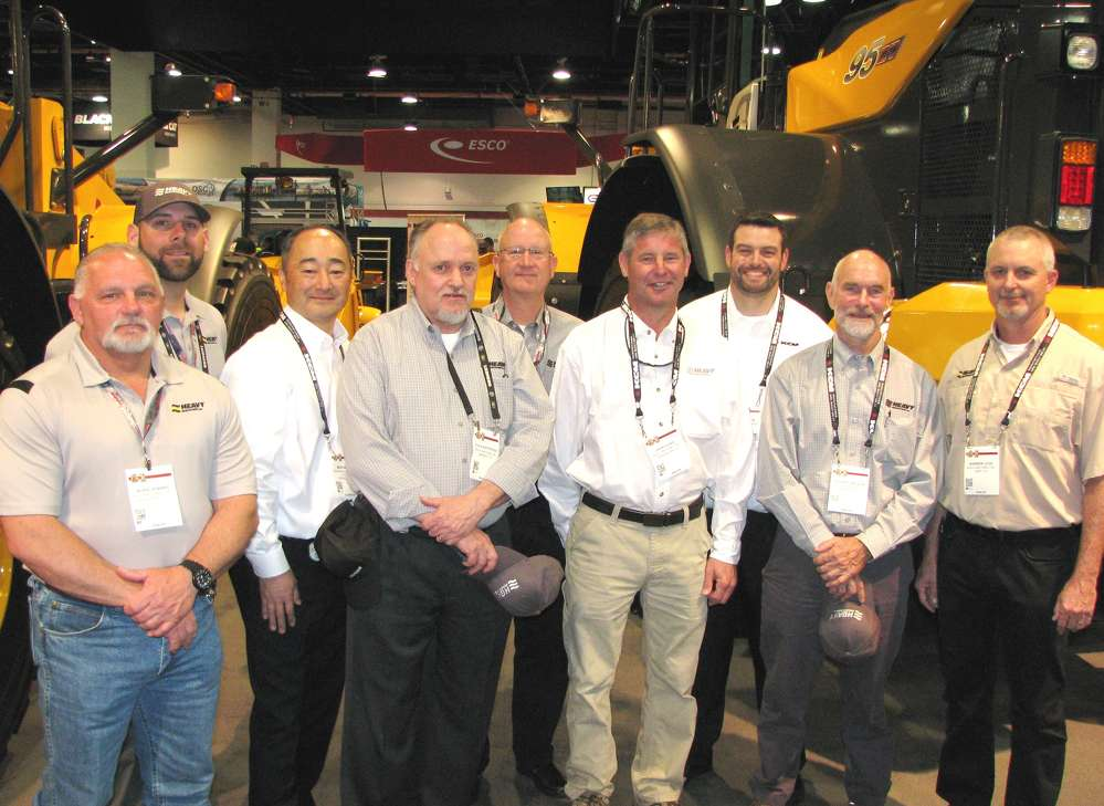 (Representatives and dealers of KCM reconnect at the exhibit area (L-R) including Jackie Sparks and Cole Thibault of Heavy Machines Inc. (HMI), Shreveport, La.; Mick Mikami, KCM; Steve Northcross and Jay Nelson, HMI, Memphis, Tenn.; John Flake, HMI Birmingham, Ala.; Chad Parker, KCM; Rich Wilson, HMI, Memphis, Tenn.; and Warren Legg, HMI, Gray, Tenn.