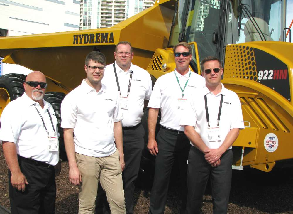 Exhibiting their uniquely designed trucks and excavators, including this Tier IV final 922HM off-road truck with increased horsepower, (L-R) are Scott Becker, Simon Kofoed-Dam, Tom Hartman, Barry Ferrell and Kris Binder, all of Hydrema.